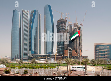 View from Emirates Palace of construction of Etihad Towers in Abu Dhabi, UAE - Stock Photo