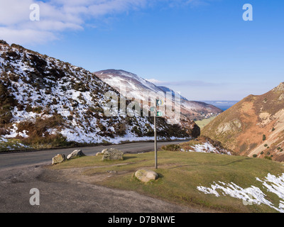 View down Sychnant Pass country road to Foel Lus hill with North Wales Path sign in Snowdonia National Park from - Stock Photo