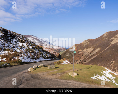 View down Sychnant Pass to coast with North Wales Path sign in Snowdonia National Park from Pensychnant, Conwy, - Stock Photo