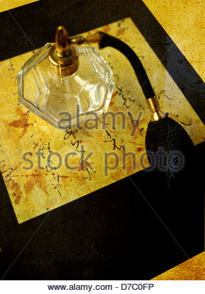 Still life of perfume decanter sitting on top of a book - Stock Photo