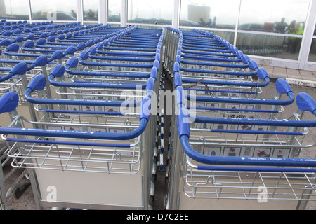 Baggage Trolley chained together at the front of remodeled Murtala Muhammed International Airport Terminal, Lagos, - Stock Photo