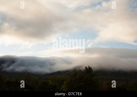 Mount Greylock in Adams, Massachusetts is covered with low-lying clouds on a fall afternoon. - Stock Photo