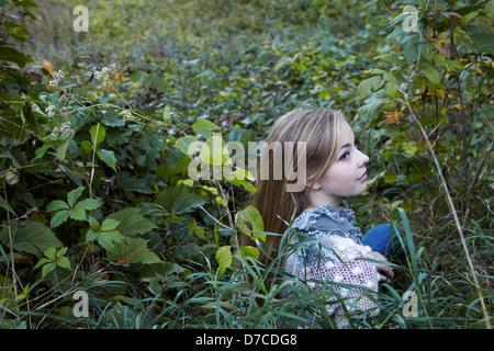 beautiful teen girl in autumn meadow - Stock Photo