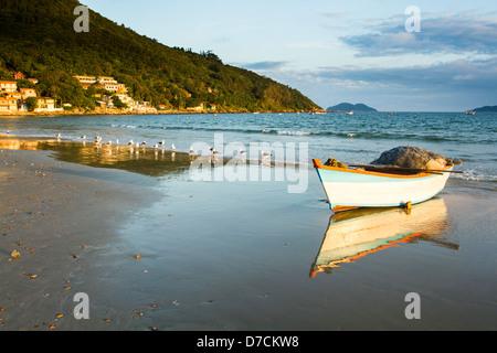 Fishing boat on the sand at Pantano do Sul Beach. - Stock Photo