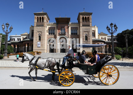 Horse-drawn carriage with tourists in Seville, Andalusia Spain - Stock Photo