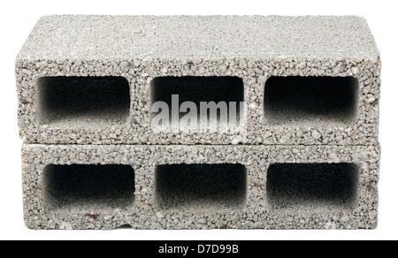 Two gray concrete construction blocks (a.k.a. cinder block breeze block cement block foundation block besser block; - Stock Photo