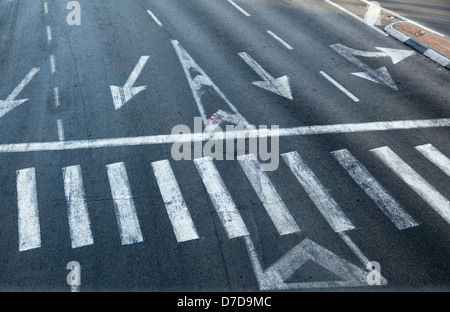 High angle view of a crosswalk on a 4 lane city street. - Stock Photo