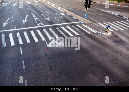 High angle view of a crosswalk on a 4 lane & 2 lane city street. - Stock Photo