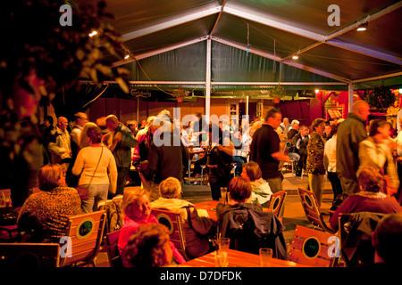 people dancing in a club at the polish seaside resort Swinoujscie, Uznam Island, Poland, Europe - Stock Photo