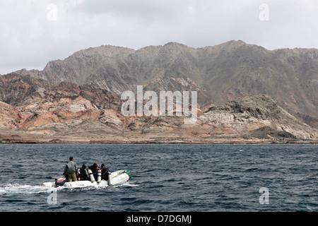 Scuba Diver on Zodiac, Hallaniyat Islands, Arabian Sea, Oman - Stock Photo