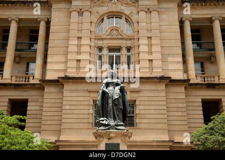 Statue of Queen Victoria and the Lands Administration Building in Queens Gardens in Brisbane, Queensland, Australia - Stock Photo