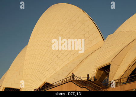 tourists in front of the giant roof of the famous opera in Sydney, New South Wales, Australia - Stock Photo