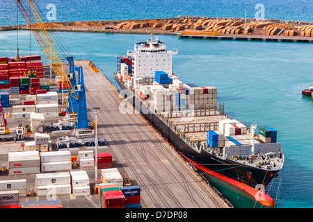 Container ship NYK Lyttelton at Napier Port, Hawke's Bay, New Zealand. Lots of containers on the dock... - Stock Photo