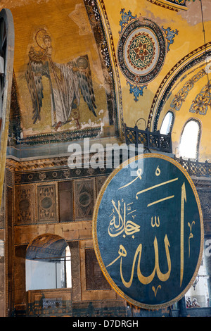 Mosaic of Gabriel and Allah script in Arabic, Hagia Sophia, Istanbul, Turkey - Stock Photo