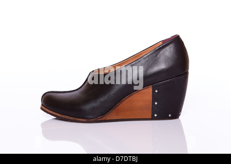 Woman leather original shoe with wedge sole - Stock Photo