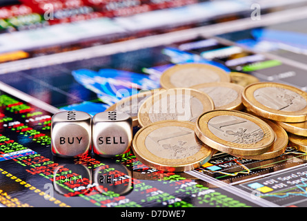 Dices cubes with the words SELL BUY, one-euro coins and a financial chart with columns of figures as the background. - Stock Photo