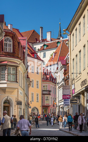 buildings of medieval high street (Pikk Street ) in Tallinn medieval old town. people tourists - Stock Photo