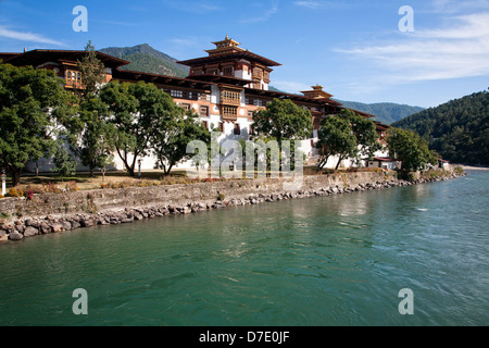The Punakha Dzong (fortress) at the confluence of the Mo and Pho Chhu (rivers). Bhutan. - Stock Photo