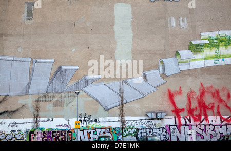 Street Art by Blu, Kreuzberg – Berlin Wall falling, Euro rising, Berlin, Germany - Stock Photo