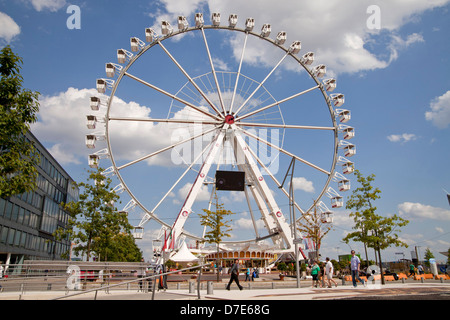 Ferris wheel in the Hafencity district, Free and Hanseatic City of Hamburg, Germany - Stock Photo
