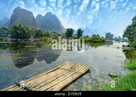 Bamboo raft at the Ulong river near Yangshuo, Guanxi province, China - Stock Photo