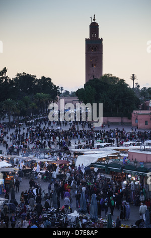 Morocco, Marrakesh - Jamaa el Fna square. View of the square by evening, with Koutoubia mosque. - Stock Photo