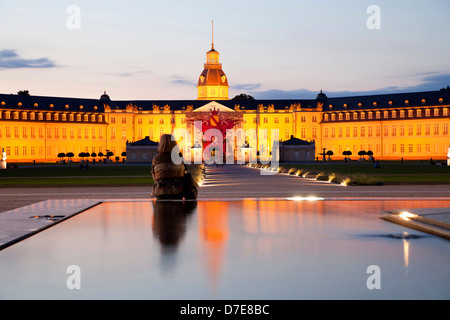 ountain in front of the illuminated Karlsruhe Palace, Karlsruhe, Baden-Wuerttemberg, Germany - Stock Photo