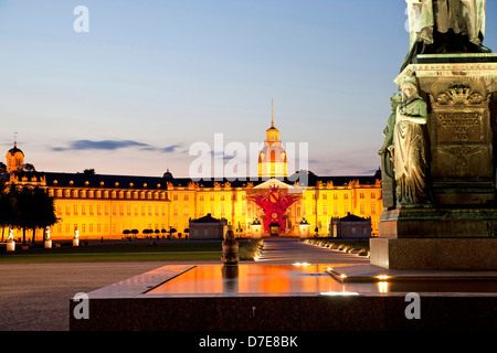 fountain in front of the illuminated Karlsruhe Palace, Karlsruhe, Baden-Wuerttemberg, Germany - Stock Photo