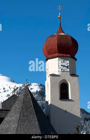 The tower of the church in St Anton, a pretty village in the Arlberg region of Austria - Stock Photo