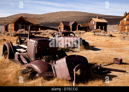 abandoned cars at the ghost town Bodie, California, United States of America, USA - Stock Photo