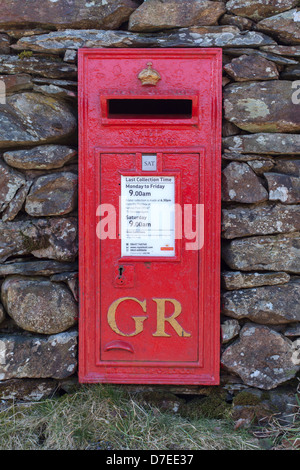 Red Post Box in dry stone wall, Loughrigg, English lake District, UK - Stock Photo