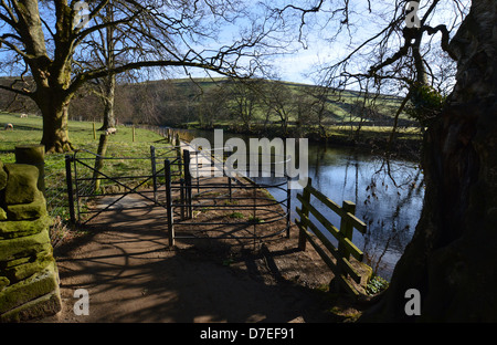 Metal Kissing Gate by the River Wharfe near Burnsall on the Dales Way Long Distance Footpath Wharfedale Yorkshire. - Stock Photo