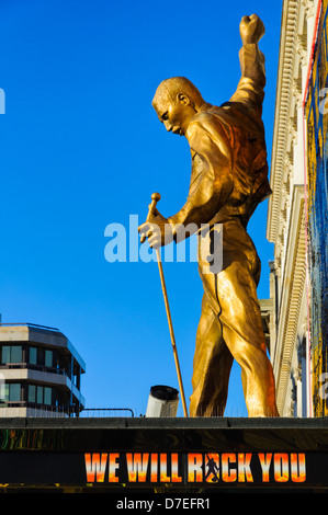 Gold Statue of Freddy Mercury of Queen on an awning at the West End theatre at which 'We Will Rock You', a musical, - Stock Photo