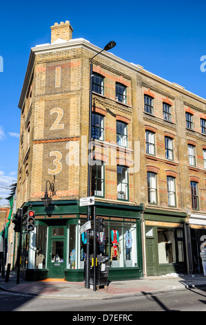 Old red brick building in London, England - Stock Photo