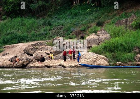 Children playing by Mekong River, Luang Prabang, Laos - Stock Photo