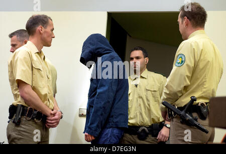 Defendant Carsten S. appears at the Higher Regional Court in Munich, Germany, 06 May 2013. He is accused of being - Stock Photo