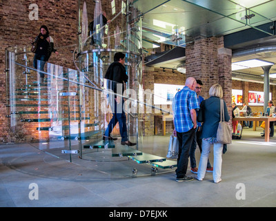 The Apple Store, Covent Garden - Shoppers on the glass staircase of the elegant Grade ll listed building - Stock Photo