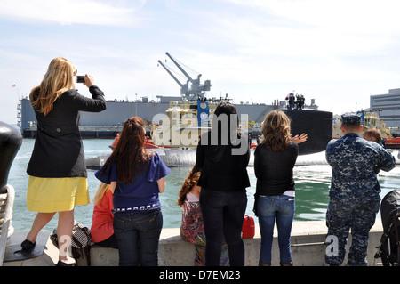 Family members watch USS Asheville depart.