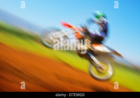 Blurred image of biker on championship, active lifestyle, extreme sport, slow motion, motocross on off-road, speed - Stock Photo