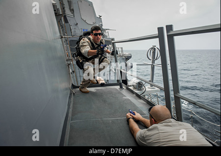 Sailors conduct VBSS training. - Stock Photo
