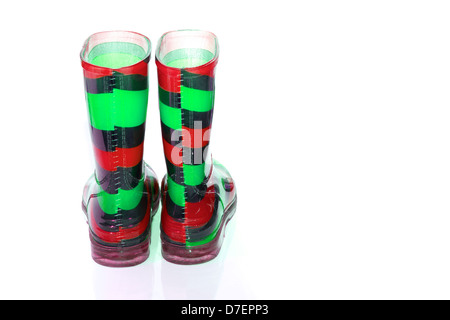 Multi Coloured wellington Boots on white with copy space - Stock Photo
