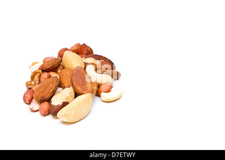 mixed nuts on white with copy space - Stock Photo