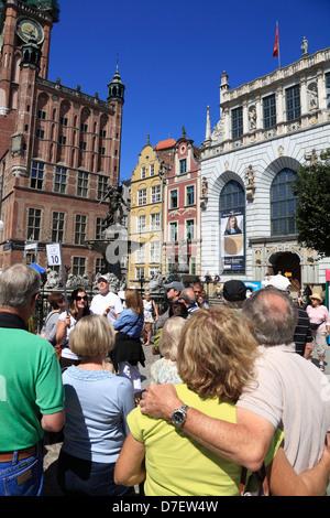 Gdansk, Tourists  at Neptun fountain,  Dlugi Targ, Long Market,   Langer Markt, Poland - Stock Photo