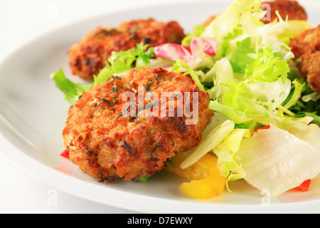 Fried vegetable burgers with green salad - Stock Photo