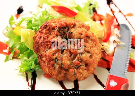 Vegetable burgers with balsamic vinegar sauce - Stock Photo