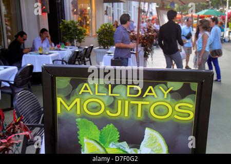 Miami Beach Florida Lincoln Road pedestrian mall shopping restaurant alfresco dining sign mojitos drinks - Stock Photo