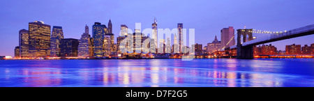 New York City Panorama at the Financial District and Brooklyn Bridge - Stock Photo