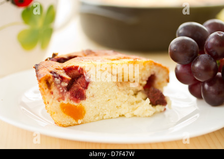 Cottage cheese cake with fruit on a plate - Stock Photo