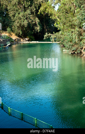 A view at Jordan river in Israel hint baptismal side on left frame. river's water eventually flows into Dead Sea - Stock Photo