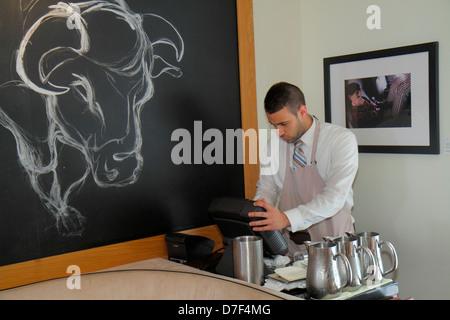 Miami Beach Florida Ocean Drive Betsy Ross Hotel BLT Steak restaurant Hispanic man waiter manager cash register - Stock Photo